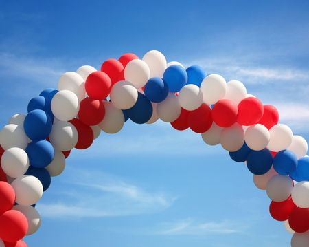 Red white and blue patriotic balloon arch background photo