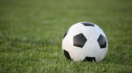 Black and white soccer ball on grass background Stok Fotoğraf