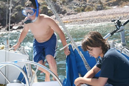 Young girl and boy on vacation on a boat at Catalina Island, California photo