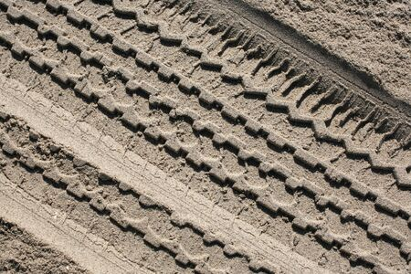 Clear impression of a tire track in beach sand background Stock Photo - 5570994