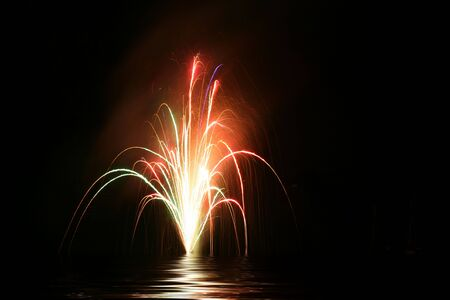 Fireworks reflected over the dark lake water Stok Fotoğraf
