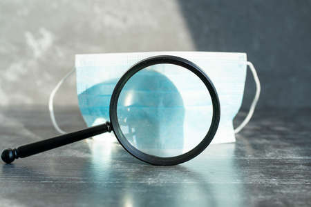 medical mask viewed under a magnifying glass.
