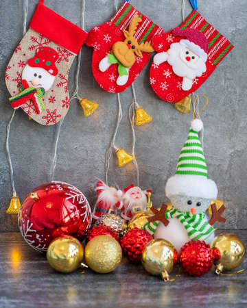 Background with Christmas red stocking on the fireplace and toys