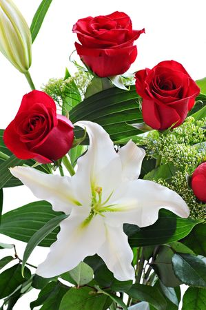 romance: Bouquet of red roses and white lily Stock Photo