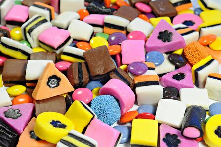 Background made of colorful candy and bonbons Stock Photo