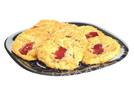 Delicious cookies with strawberry jam on a plate, white background