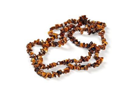 Necklace made of semi-precious stones, on white background; Tiger eye stones Stock Photo