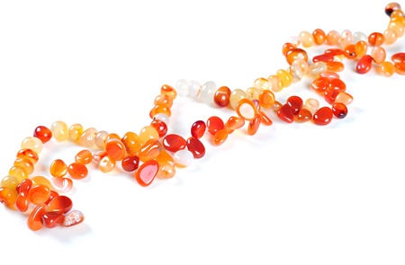 Necklace made of semiprecious stones, on white background; Carnelian stones Stock Photo