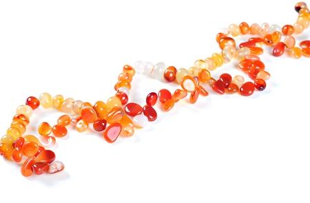 Necklace made of semiprecious stones, on white background; Carnelian stones Stock Photo