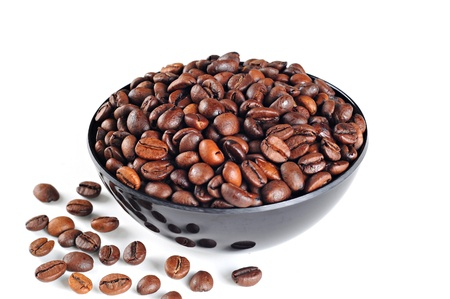 Bowl with coffee beans, on white background