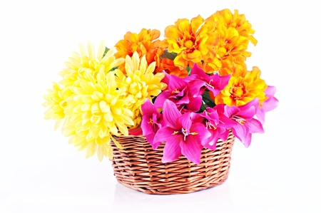 Colorful flowers in wooden basket, white background Stock Photo