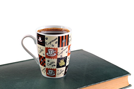 Coffee mug and books on a white background