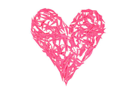 Red heart made of small peaces of paper