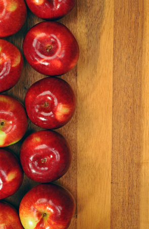 Red tasty apples on a wooden table Stock Photo