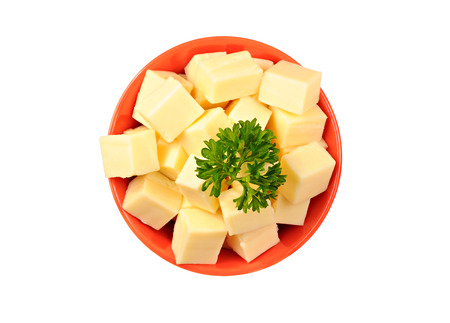 Red bowl with mozzarella cheese and parsley, on white background
