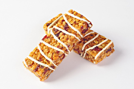 Two cereal bars with wheat, cranberries and yogurt
