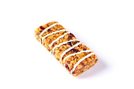 Cereal bar with wheat, cranberries and yogurt, on white background