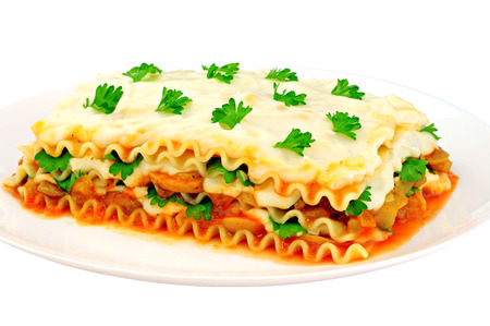 Delicious lasagna slice on a plate, isolated on white background Stock Photo
