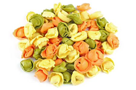Raw colored tortellini on a white background Stock Photo