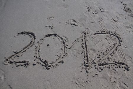 New year 2012 on the beach written on the sand photo