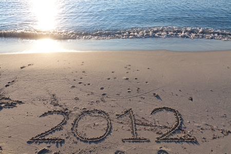 New year 2012 on the beach written on the sand Stock Photo - 10532153