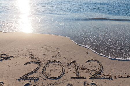 New year 2012 on the beach written on the sand Stock Photo - 10532151
