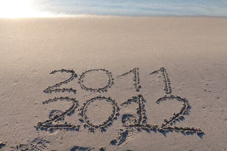 New year 2012 on the beach written on the sand Stock Photo - 10532217