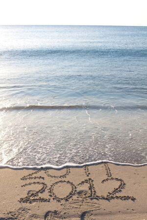 New year 2012 on the beach written on the sand Stock Photo - 10532067