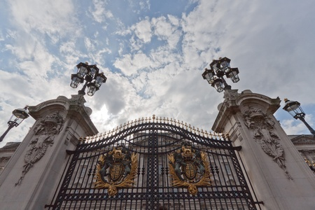 Buckingham Palace entrance with Windsor coat of arms on the gate