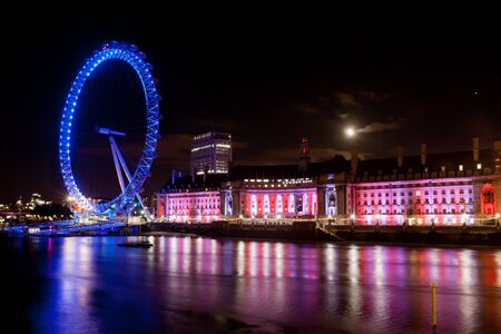 London Eye night shot with Thames in front