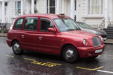 London Red Taxy on the road of the city