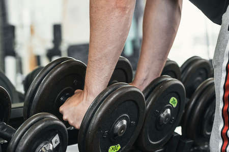 lifting weights in the gym. Material care.
