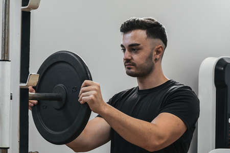 boy preparing weights to lift