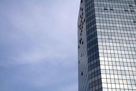Skyscraper windows and clouds #3 - left copyspace photo