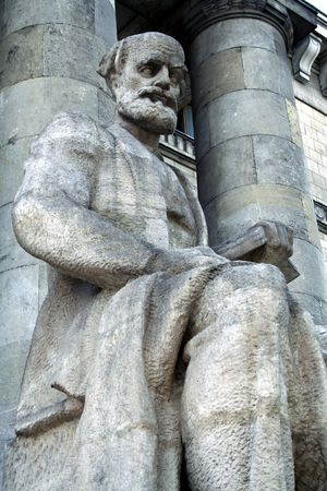 iron curtain: Communist thinker statue near Palace of Culture in Warsaw, Poland Stock Photo