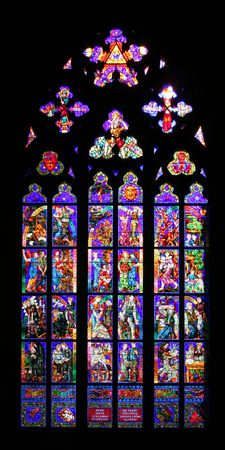Beautiful stained glass window at St. Vitus cathedral in Prague