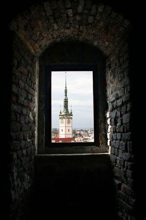 olomouc: View of town hall tower of Olomouc through a church window