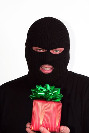 shoplifter: Criminal series 9 - masked bandit holding a wrapped Christmas gift