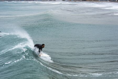 Surfer on a wave 스톡 콘텐츠 - 132066108