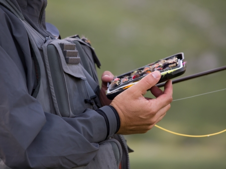 fly fishing: Fly fishermen is picking out the bait Stock Photo