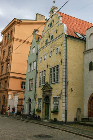 Riga, Latvia- June 29 2020: Three brothers is the oldest dwelling complex in Riga. It's been constructed at the end of 15th century, when Riga has established contacts with merchants from Netherlands and as a result some characteristics of architecture of
