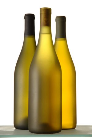 Three White wine Bottles close grouping