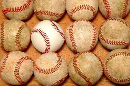 Dozen baseballs 11 old & 1 new