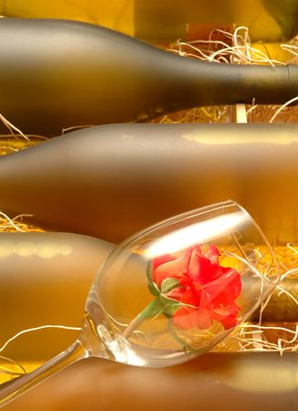 Wine bottles with a red rose in a glass Stock Photo - 432202