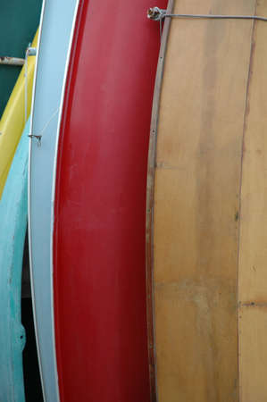 Row Boats stacked on end 版權商用圖片