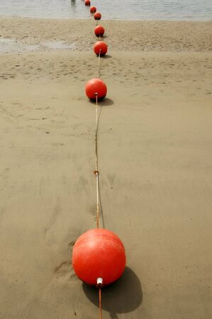 Orange Buoys at low tide