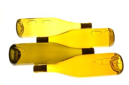Four White wine Bottles on sides with whitelight table  background Stock Photo - 432023