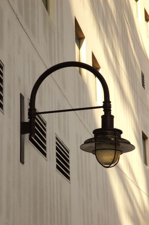 street lamp: Street Lamp Attached to Modern Building Stock Photo