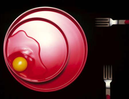 albumen: Raw Egg on Red Plate Stock Photo