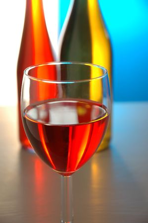 Wine Glass with 2 Bottles behind Stock Photo - 453066